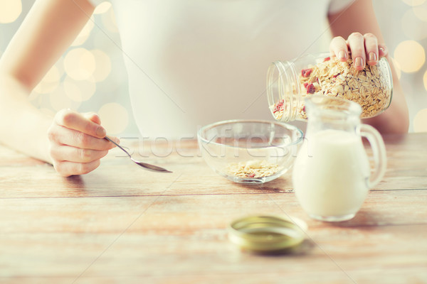 close up of woman eating muesli for breakfast Stock photo © dolgachov