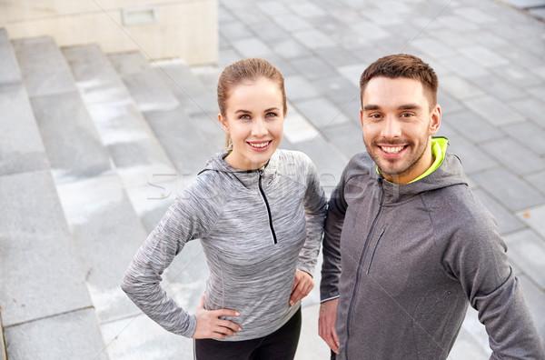 smiling couple outdoors on city street Stock photo © dolgachov