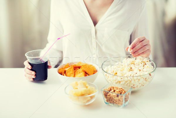 close up of woman with junk food and cola cup Stock photo © dolgachov