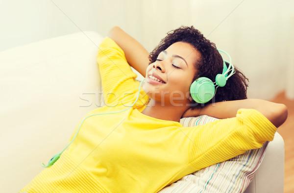 Stok fotoğraf: Mutlu · kadın · kulaklık · insanlar · teknoloji