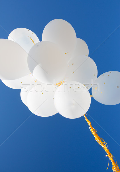 close up of white helium balloons in blue sky Stock photo © dolgachov