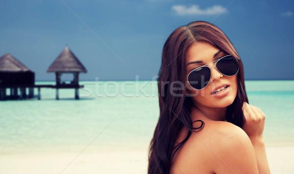 Occhiali da sole spiaggia turismo viaggio Foto d'archivio © dolgachov