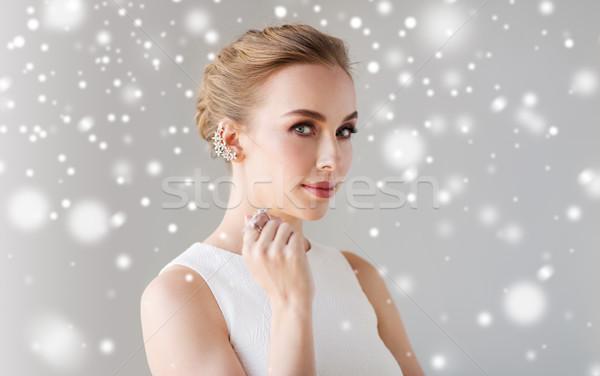 woman in white dress with diamond jewelry and snow Stock photo © dolgachov