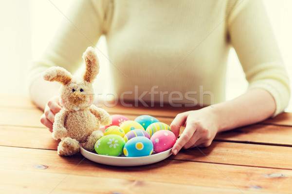 close up of woman hands with easter eggs and bunny Stock photo © dolgachov