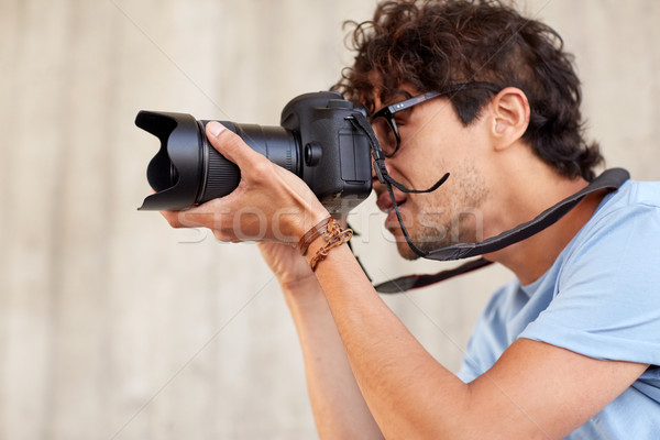close up of  photographer with camera shooting Stock photo © dolgachov