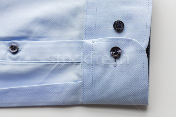close up of blue shirt sleeve Stock photo © dolgachov