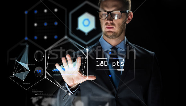 businessman touching virtual screen projection Stock photo © dolgachov