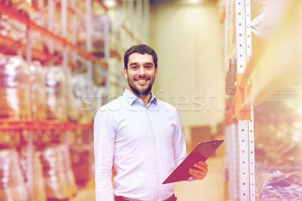Boldog üzletember vágólap raktár nagybani eladás üzlet Stock fotó © dolgachov