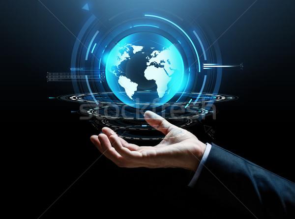 Zakenman hand virtueel aarde projectie business Stockfoto © dolgachov