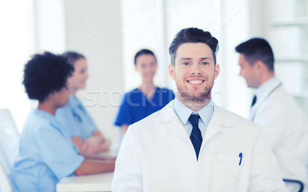 Boldog orvos csoport kórház klinika hivatás Stock fotó © dolgachov