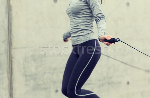 close up of woman exercising with jump-rope Stock photo © dolgachov