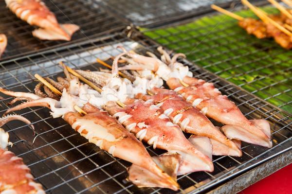 squids on grill at street market Stock photo © dolgachov