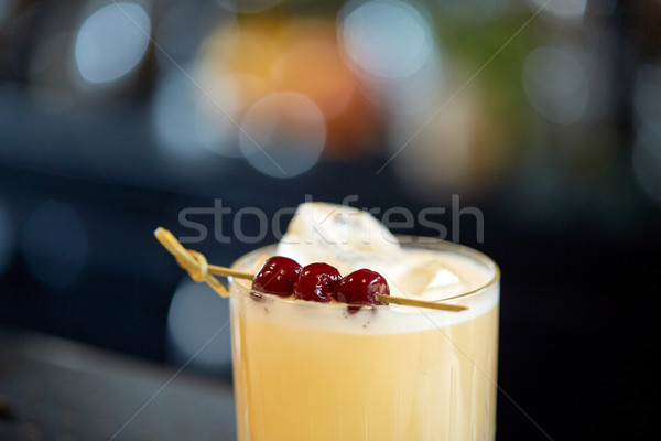 close up of cocktail glass with cherries at bar Stock photo © dolgachov