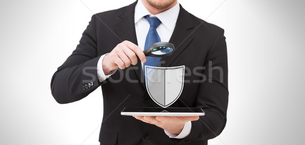 businessman with tablet pc antivirus program icon Stock photo © dolgachov