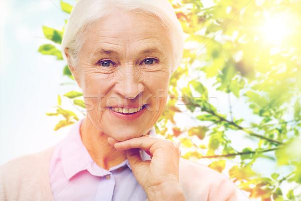 happy senior woman over green natural background Stock photo © dolgachov