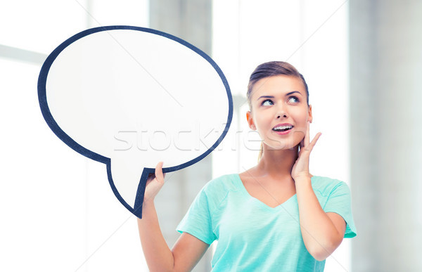 smiling student with blank text bubble Stock photo © dolgachov
