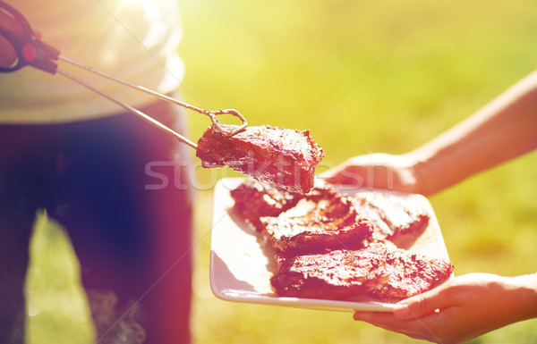 man cooking meat at summer party barbecue Stock photo © dolgachov