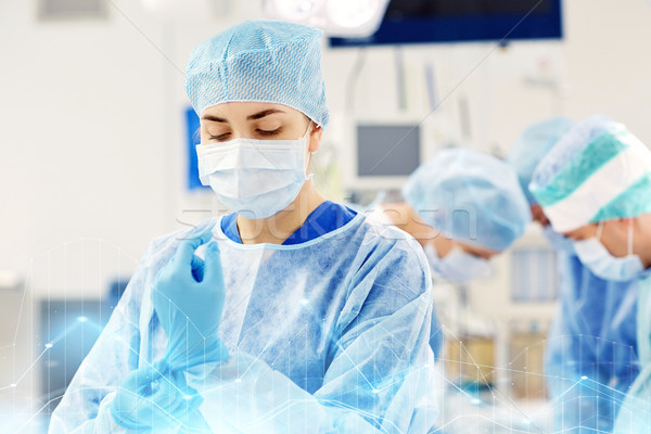 surgeon in operating room at hospital Stock photo © dolgachov