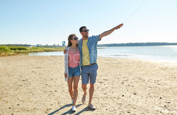 happy couple walking along summer beach Stock photo © dolgachov
