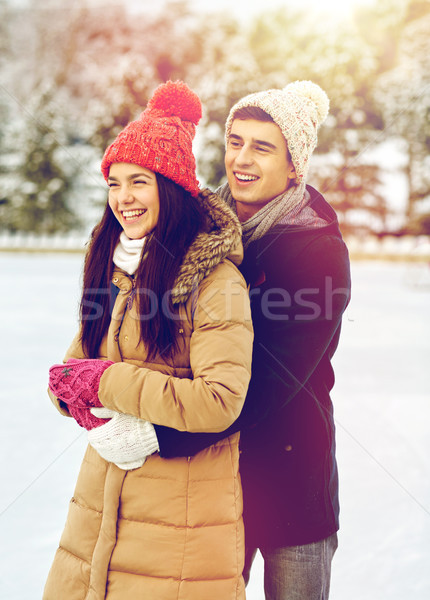 Stock photo: happy couple ice skating on rink outdoors