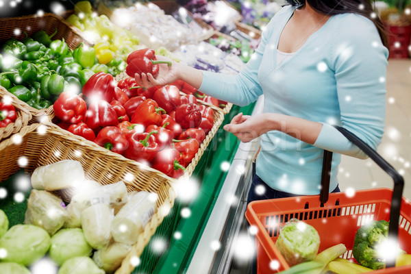 customer buying peppers at grocery store Stock photo © dolgachov