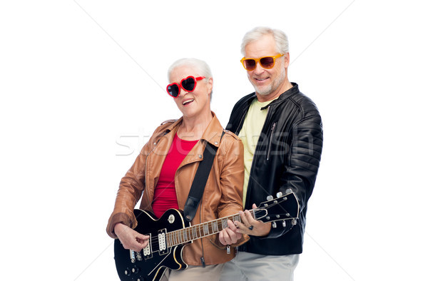 Idős pár napszemüveg elektromos gitár zene kor emberek Stock fotó © dolgachov