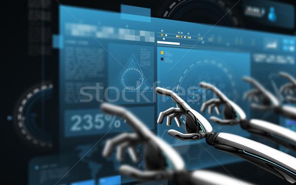robot hands touching virtual screens over black Stock photo © dolgachov
