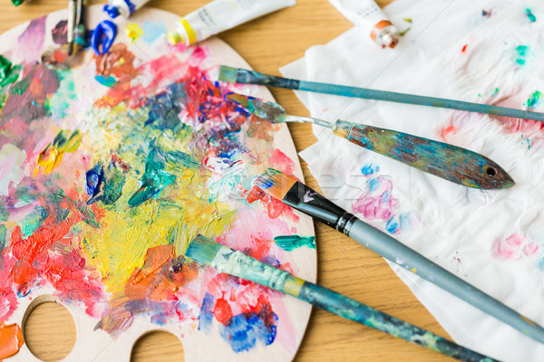 palette knives or painting spatulas and brushes Stock photo © dolgachov