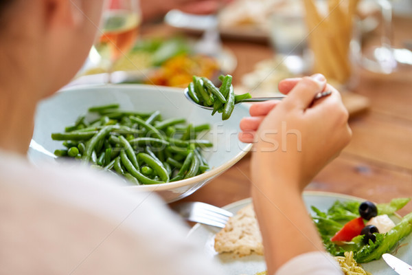 close up of woman eating green beans Stock photo © dolgachov