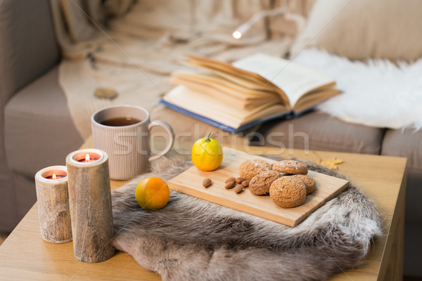 cookies, lemon tea and candles on table at home Stock photo © dolgachov