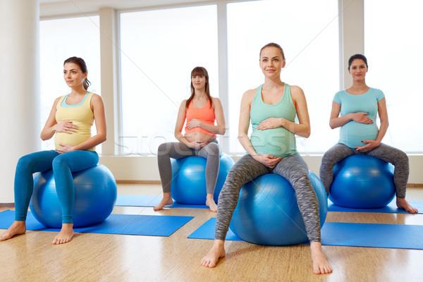 pregnant women sitting on exercise balls in gym Stock photo © dolgachov