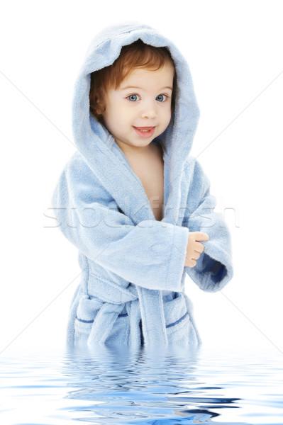 Bebê menino azul robe água criança Foto stock © dolgachov