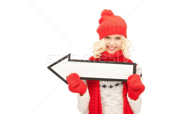 Kadın yön ok işareti resim imzalamak Stok fotoğraf © dolgachov