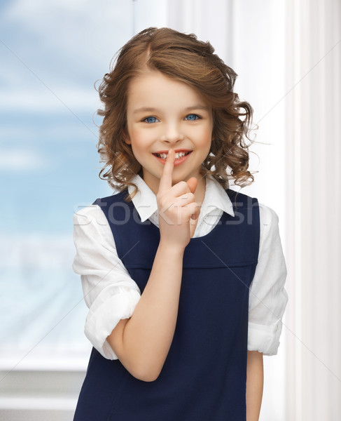 pre-teen girl showing hush gesture Stock photo © dolgachov