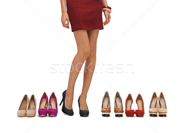 woman's long legs with high heels Stock photo © dolgachov