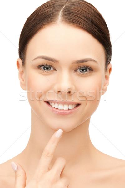 Mulher tocante queixo cara bela mulher mão Foto stock © dolgachov
