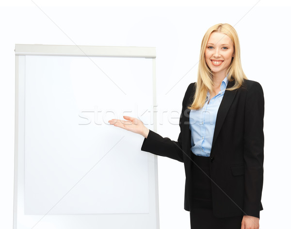 Imprenditrice lavagna a fogli mobili ufficio istruzione donna felice Foto d'archivio © dolgachov