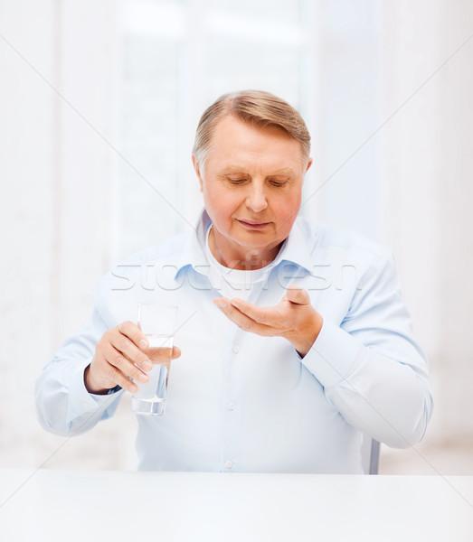 Stary pigułki szkła wody opieki zdrowotnej apteki Zdjęcia stock © dolgachov