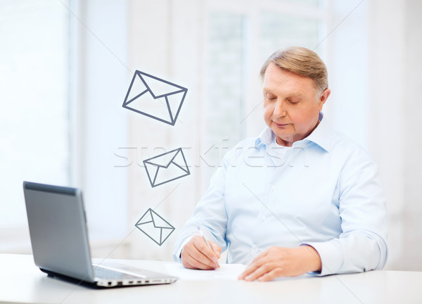 old man filling a form at home Stock photo © dolgachov