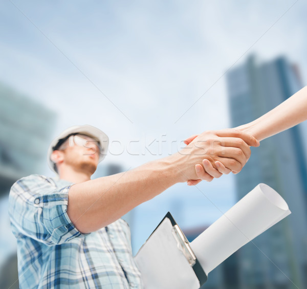 builder with blueprint shaking partner hand Stock photo © dolgachov