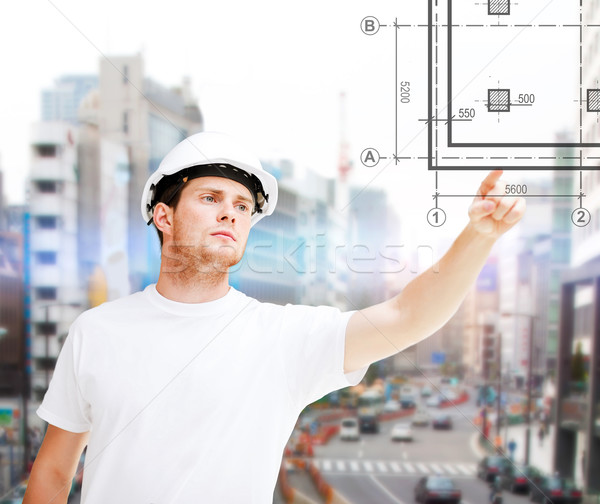male architect pointing to blueprint Stock photo © dolgachov