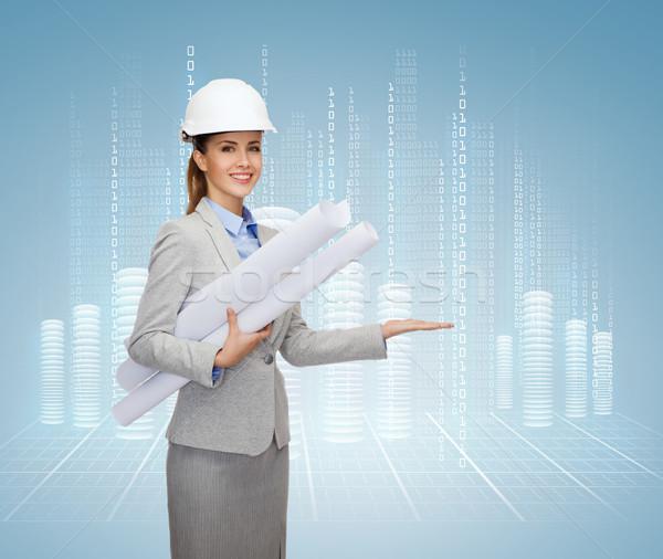 Glimlachend architect witte helm blauwdrukken gebouw Stockfoto © dolgachov