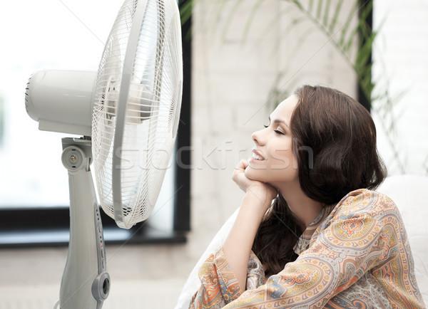 happy and smiling woman sitting near ventilator Stock photo © dolgachov