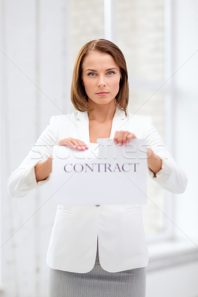 concentrated businesswoman tearing contract Stock photo © dolgachov
