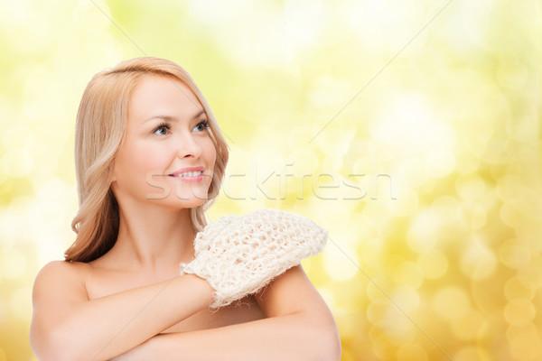 smiling woman with exfoliation glove Stock photo © dolgachov