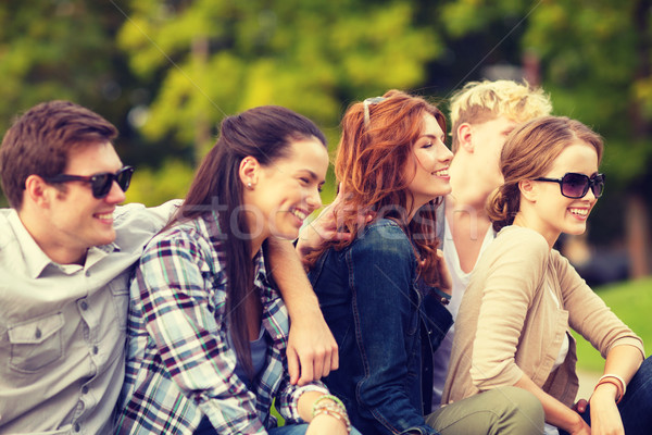 group of students or teenagers hanging out Stock photo © dolgachov