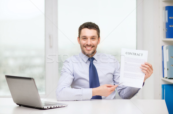 businessman with laptop and contract at office Stock photo © dolgachov