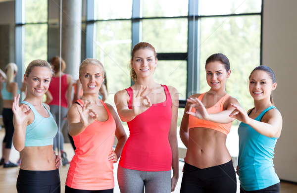 group of women showing ok sign in gym Stock photo © dolgachov