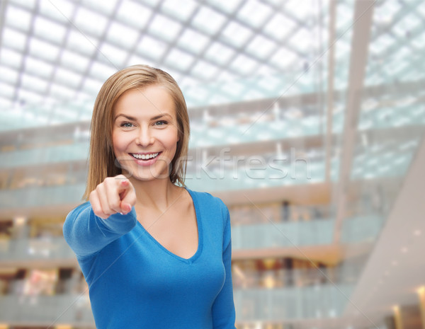 smiling student pointing finger at you Stock photo © dolgachov