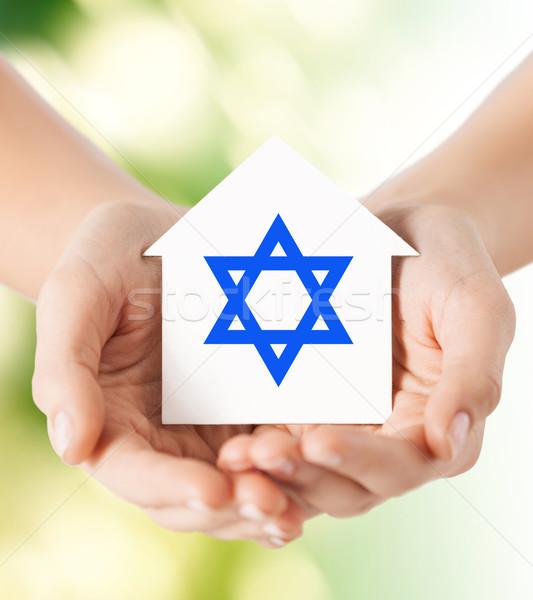 Mãos casa estrela religião Foto stock © dolgachov